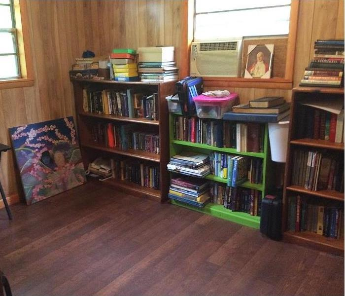 Books are nicely organized on bookshelves. The floor is clean and free of clutter and filth.