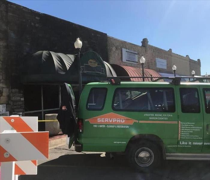 A SERVPRO van sits in front of a restaurant that suffered from a fire.