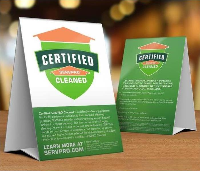 Two paper standees with the words Certified: SERVPRO Cleaned and information about SERVPRO.